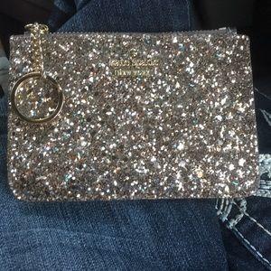 Kate spade bitsy card wallet.